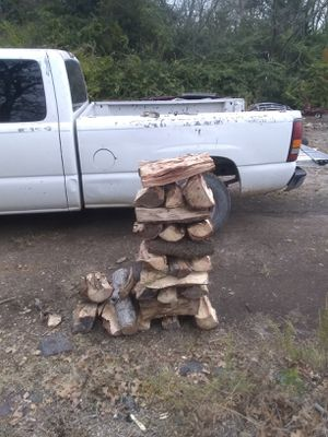 Stack of pecan cooking wood big pieces for Sale in Dallas, TX