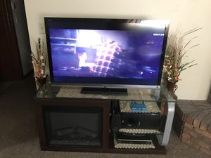 """Fire place tv stand with 49"""" tv for Sale in Lincoln, NE"""