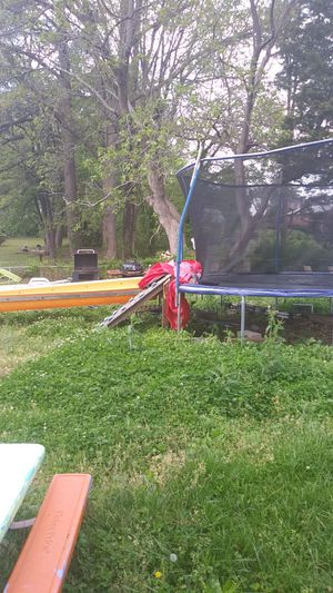 Large trampoline.with stand alone slde and rock. Climber and all weather cover. With open up windows for Sale in Crewe, VA