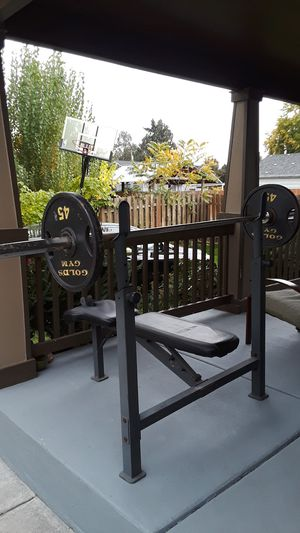 Bench press and 45 pound weights on each side. for Sale in Salem, OR