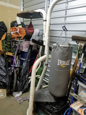Complete NEW 60 lbs punching bag with (used) stand, (used) hand wraps, and NEW XL training gloves ! for Sale in Covina, CA