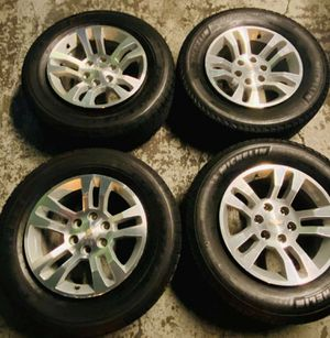 "18""wheels and tires 6x139 Chevy Silverado.80% tread for Sale in San Diego, CA"