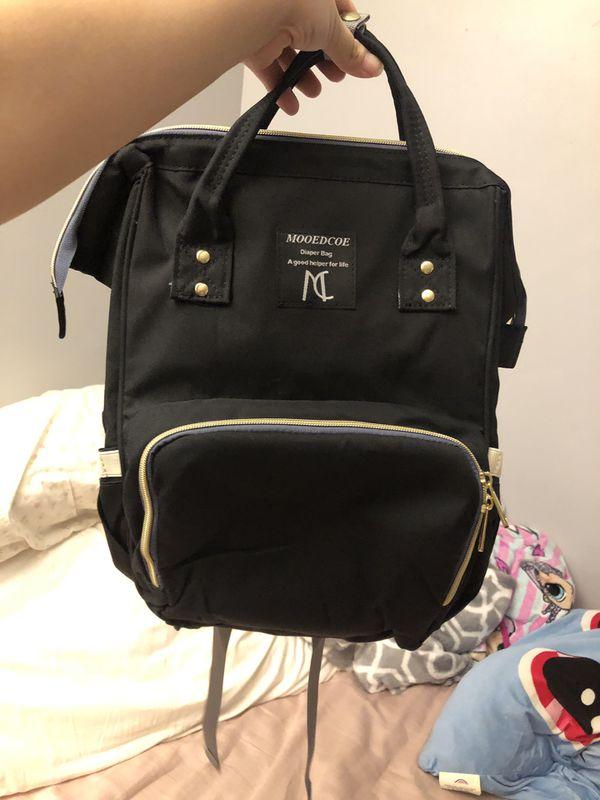 Multifunctional diaper bag backpack