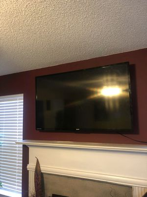 55 inch tv mounted over fire place! Tv mounting! Tv installs! Tv installation! for Sale in Atlanta, GA