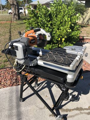 """Ridged laser tile cutter hitachi 10"""" table saw with stand dewalt miter saw stand for Sale in Cape Coral, FL"""