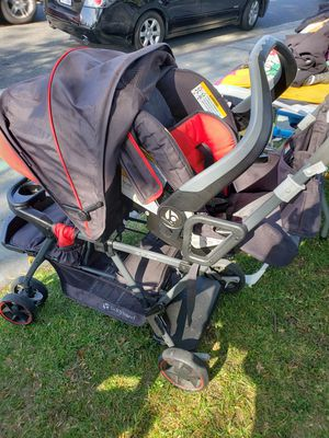 Double stroller siting stand with baby trend car seat in perfect condition hardly used for Sale in Los Angeles, CA