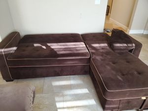 Sectional couch that folds out to a queen size bed for Sale in Clovis, CA