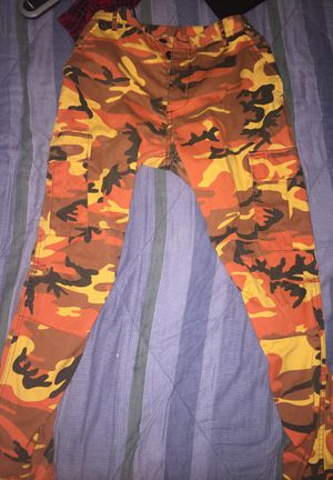 Orange and black camo cargo pants for Sale in Fairview, OR