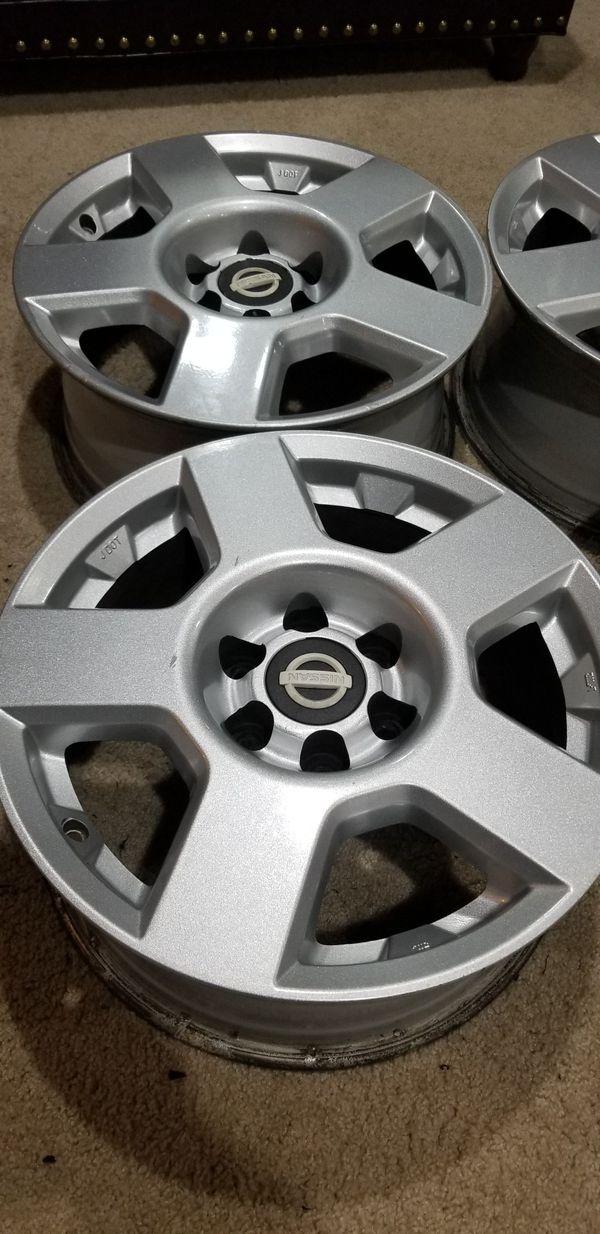 4 used xterra wheels