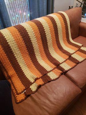 Handmade afghan orange yellow brown for Sale in Orlando, FL
