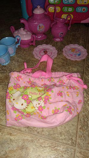 Princess tea set and a hello Kitty bag for Sale in Glendora, CA