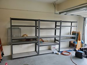 Metal shelving towers w/5 adjustable shelves (photo shows 3, but only 1 remaining) for Sale in Mission Viejo, CA