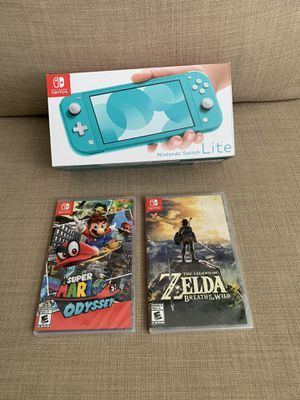 Nintendo Switch Lite - Turquoise with two games for Sale in Glendale, AZ