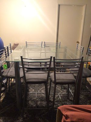 High metal table (top glass) 8 chairs (NOT FREE) for Sale in Los Angeles, CA