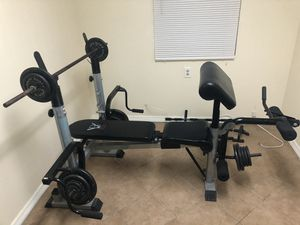 Weight bench W/ Leg and Arm lift! Weights included! Awesome condition for Sale in Pinellas Park, FL