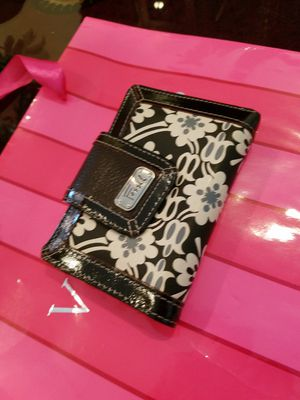 Authentic Fossil brand black and white flower print wallet with red lining, lots of compartments, excellent quality and in excellent condition for Sale in Pembroke Pines, FL