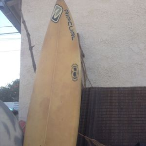 SURFBOARD BY RIP CURL WITH TAIL PAD for Sale in Paramount, CA