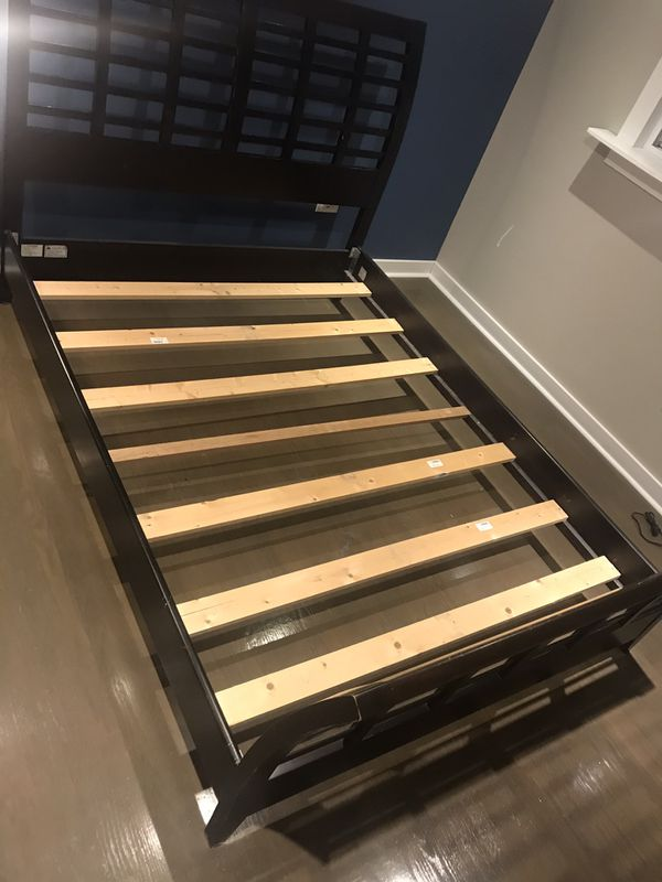 Queen size bed. Mattress and box spring not included