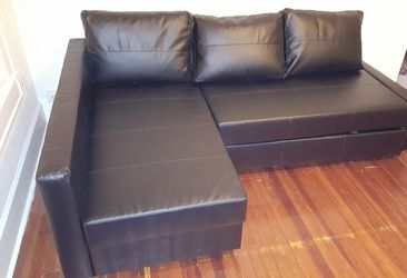 Black ikea sleeper sectional sofa couch w storage in chaise for Sale in St. Petersburg,  FL