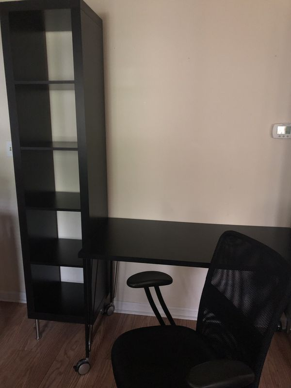 Desk, tower bookcases, and chair