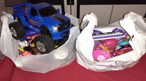 2 bags of toys for boy and girl both for $10 firm for Sale in Stockton, CA