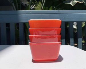 Set of 4 vintage Pyrex red 501 refrigerator dishes for Sale in Huntington Beach, CA