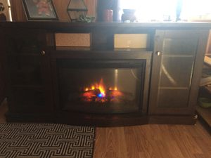 Dark mahogany entertainment center with built in electric fireplace all digital dimmer options slightly used but beautiful peice for Sale in Kingsport, TN
