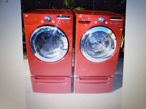 LG RED WASHER AND ELECTRIC DRYER SUPERCAPACITY WITH PEDESTALS for Sale in Medley, FL