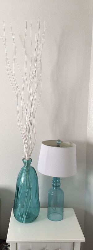 Teal / blue glass lamp and vase with branches for Sale in Orlando, FL