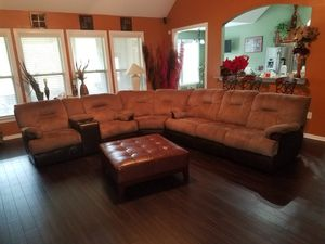 Oversized 4 seat recliner sectional trimmed in leather with otterman and coffee table. for Sale in Perry, GA