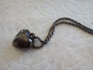 Dark silver tone charm w/chain. for Sale in Colorado Springs, CO