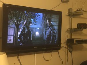 "Sony Bravia 48 ""tv ,wall mount, free shelving unit READ description... for Sale in Chicago, IL"