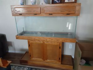55 gallon fish tank with under gravel filter, rocks and a lot of decor. Comes in an oak cabinet with canopy. for Sale in Denver, CO