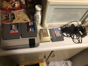 Original first year Nintendo entertainment system. Comes with Tecmo Super Bowl the legend of Zelda gold case Nintendo ice hockey super Mario brothers for Sale in Cleveland, OH