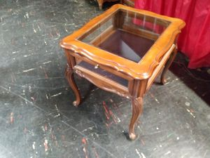 Glass top end table with storage display for sale for Sale in St. Louis, MO