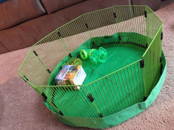 Brand new. NEVER used critter cage with food dispenser.