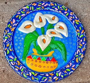 "11"" D south american mexican ? Folk art bright terracotta art pottery wall plaque with lillies for Sale in Saginaw, MI"