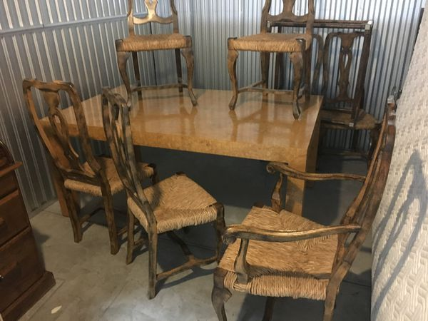 Wood dinning room table with 2 expansion pieces and 8 chairs