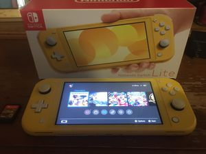 Nintendo switch lights in the color yellow including charger overwatch legend of Zelda Mario kart deluxe eight super smash brothers and Pokémon sword for Sale in Anaheim, CA