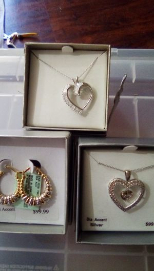 Stirling's silver necklace with heart reg. Price $100.00 asking $50.00 diamond accent earrings reg.price.$100.00 asking $50.00 great Christmas gifts for Sale in Fresno, CA