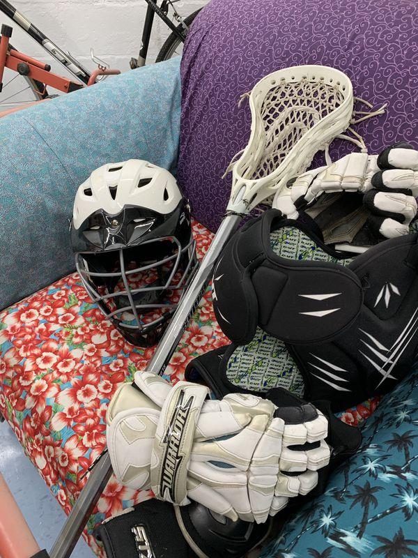 Brine Lacrosse Helmet. Warrior Lacrosse gloves.