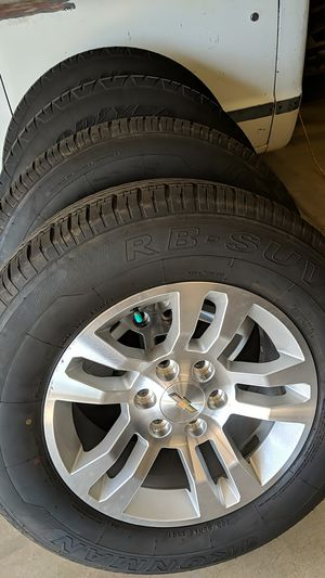 265 65 18 tires and Silverado truck wheels for Sale in Chandler, AZ