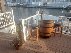 Bistro set: glass top wine barrel table and two stools. Nautical decor furniture beach dock for Sale in Bayville, NJ