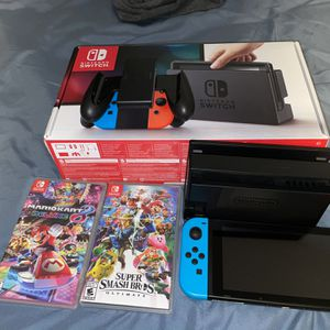 Nintendo Switch Blue & Red 10/10 condition + 2 games for Sale in Fort Lauderdale, FL