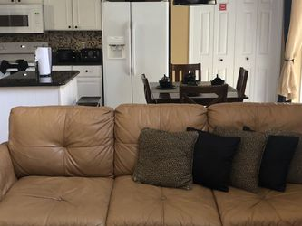 LEATHER SOFA AND LOVESEAT (TAN) for Sale in Kissimmee, FL