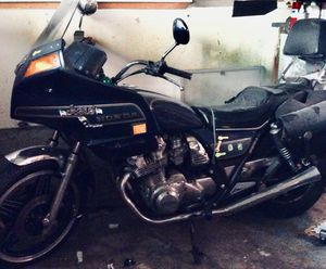 Honda 1981 CB 750 Custom Motorcycle. It has low mileage 20,877. Survivor bike needs tender loving care will include black saddle bags with 2 helmets for Sale in Seattle, WA