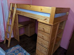 Twin loft bed with desk, drawers and book shelf. for Sale in Buckley, WA
