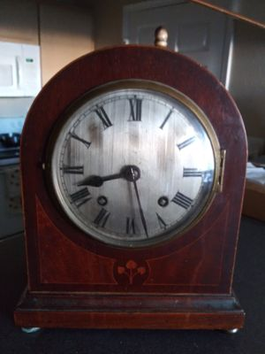Antique mantle clock with beautiful inlaid wood for Sale in Roanoke, TX