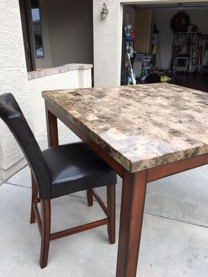 "Granite top table 54 "" square x 3 ' high. Includes 4 dark brown chairs for Sale in Phoenix, AZ"