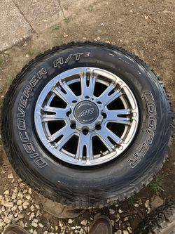 "4 dodge 17"" American racing rims w/3 cooper at/3 tires 285/70r17 for Sale in Amity,  OR"